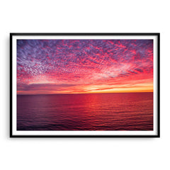 Sunset over the ocean at Mettams Pool in Perth, Western Australia framed in black