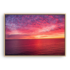 Sunset over the ocean at Mettams Pool in Perth, Western Australia framed canvas in raw oak