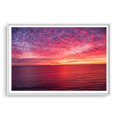 Sunset over the ocean at Mettams Pool in Perth, Western Australia framed in white