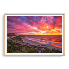 Stunning sunset over North Beach in Perth, Western Australia framed in raw oak