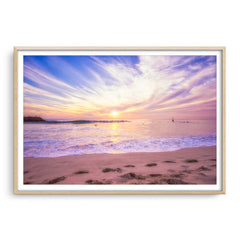 Soft pastel sunset over Cottesloe in Western Australia framed in raw oak
