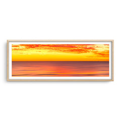 Golden skies over the ocean in Perth, Western Australia framed in raw oak