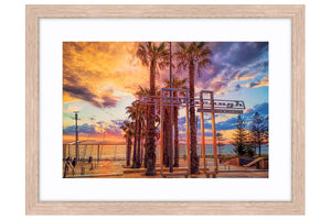 Stormy sunset at Scarborough Beach in Perth, Western Australia framed in raw oak