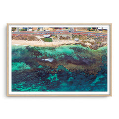 Aerial view of the reef at Mettams Pool in Perth, Western Australia framed in raw oak