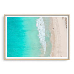 Aerial view of surfers at Trigg Beach in Perth, Western Australia framed in raw oak