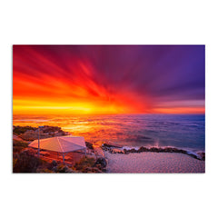 An explosive sunset over Mettams Pool in Perth, Western Australia
