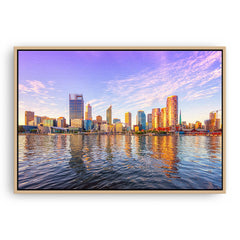 Perth city from the Swan River glowing in the afternoon sun, Western Australia framed canvas in raw oak