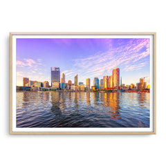 Perth city from the Swan River glowing in the afternoon sun, Western Australia framed in raw oak