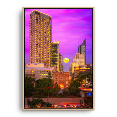Moon rising through the city of Perth, Western Australia framed canvas in raw oak