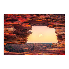 The moon rising through Natures Window in Kalbarri, Western Australia