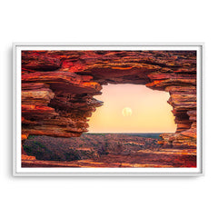The moon rising through Natures Window in Kalbarri, Western Australia framed in white
