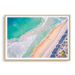 Aerial view of surf at Trigg Beach in Perth, Western Australia framed in raw oak