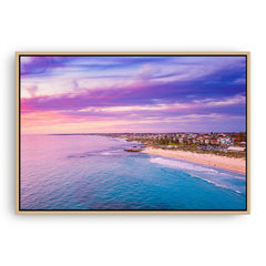 Aerial view of sunset over Trigg Beach in Perth, Western Australia framed canvas in raw oak