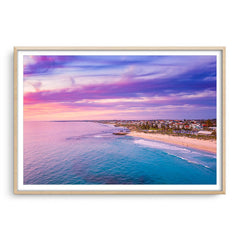 Aerial view of sunset over Trigg Beach in Perth, Western Australia framed in raw oak