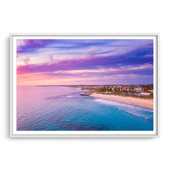 Aerial view of sunset over Trigg Beach in Perth, Western Australia framed in white
