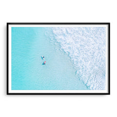 Aerial view of surfers at Trigg In Perth, Western Australia framed in black