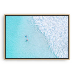 Aerial view of surfers at Trigg In Perth, Western Australia framed canvas in raw oak