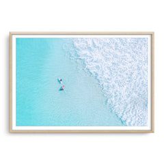 Aerial view of surfers at Trigg In Perth, Western Australia framed in raw oak
