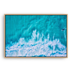 Aerial view of surfer at Trigg in Perth, Western Australia framed canvas in raw oak