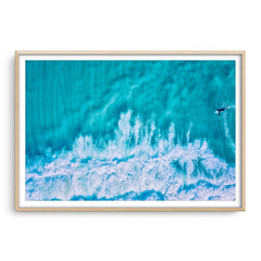 Aerial view of surfer at Trigg in Perth, Western Australia framed in raw oak