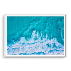 Aerial view of surfer at Trigg in Perth, Western Australia framed in white