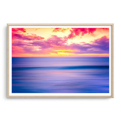 Sunset over Bennion Beach in Perth, Western Australia framed in raw oak