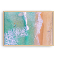 Aerial view of surfers at Trigg Beach in Perth, Western Australia framed canvas in raw oak