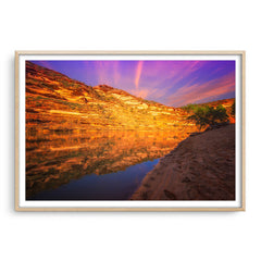 Sunset in Kalbarri National Park in Western Australia framed in raw oak