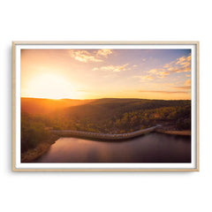 Sunset over Collie Dam in Western Australia framed in raw oak