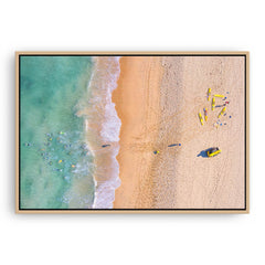 Aerial view of swimmers at Trigg Beach in Perth, Western Australia framed canvas in raw oak