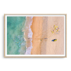 Aerial view of swimmers at Trigg Beach in Perth, Western Australia framed in raw oak