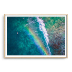 Rainbow wave in Perth, Western Australia framed in raw oak