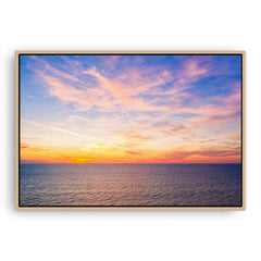 Sunset over the coast of Trigg in Perth, Western Australia framed canvas in raw oak