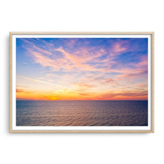 Sunset over the coast of Trigg in Perth, Western Australia framed in raw oak