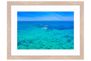 Tiny Island off the Perth Coastline in Western Australia framed in raw oak