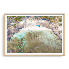 Aerial view of Mettams Pool in Perth, Western Australia framed in raw oak