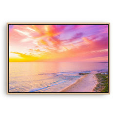 Sunset over Trigg Beach in Perth, Western Australia framed canvas in raw oak