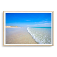 Cable Beach in Broome, Western Australia framed in raw oak