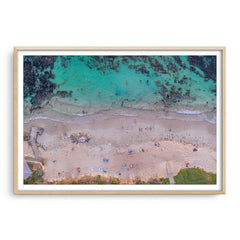 Aerial view of social distancing at Mettams Pool in Western Australia framed in raw oak