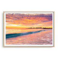 Winter sunset over Sorrento Beach in Perth, Western Australia framed in raw oak