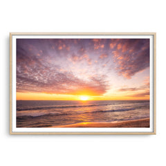 Simple sunset over Mettams Pool in Perth, Western Australia framed in raw oak