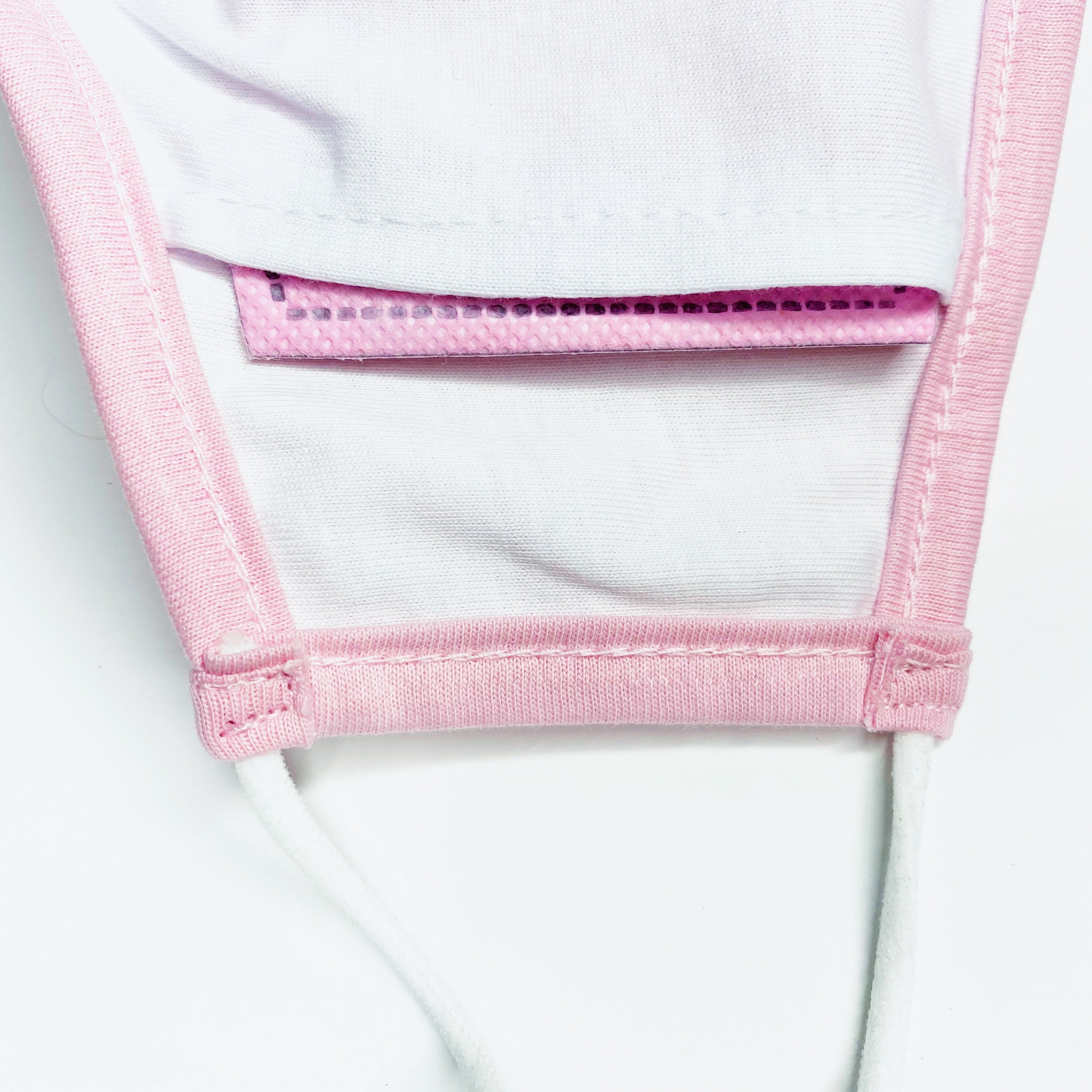 Pink breast cancer mask interior with filter pocket to insert pink protective filter