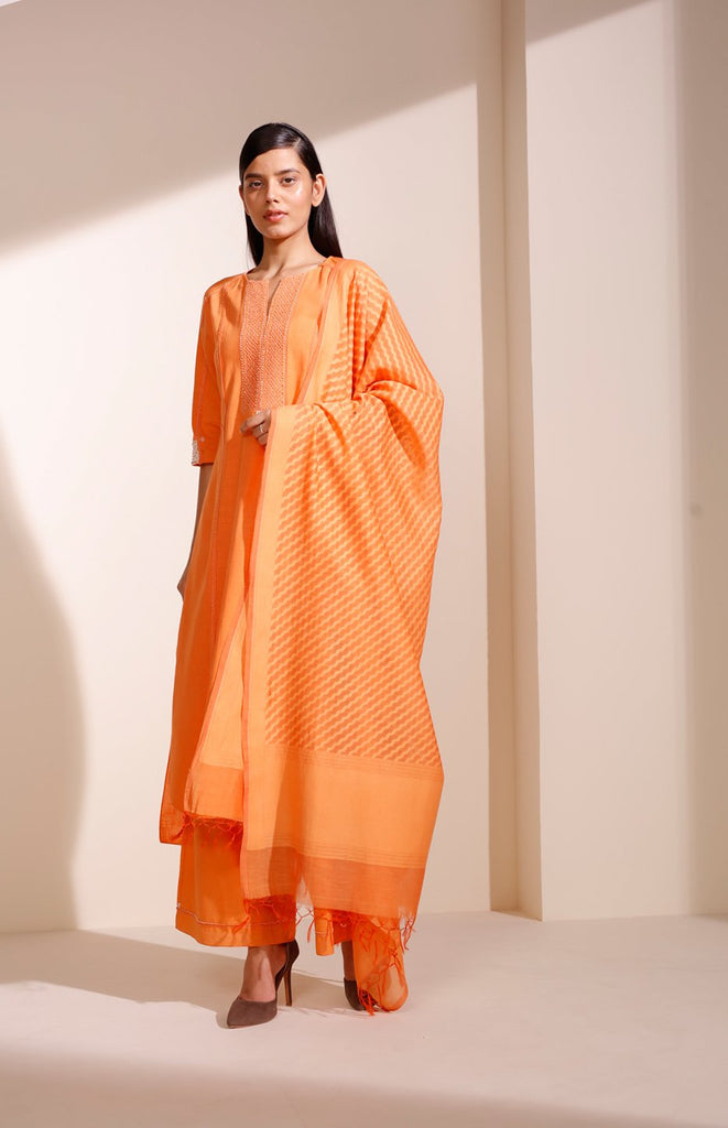 Orange Suit In Khadi With Detailed Embroidery