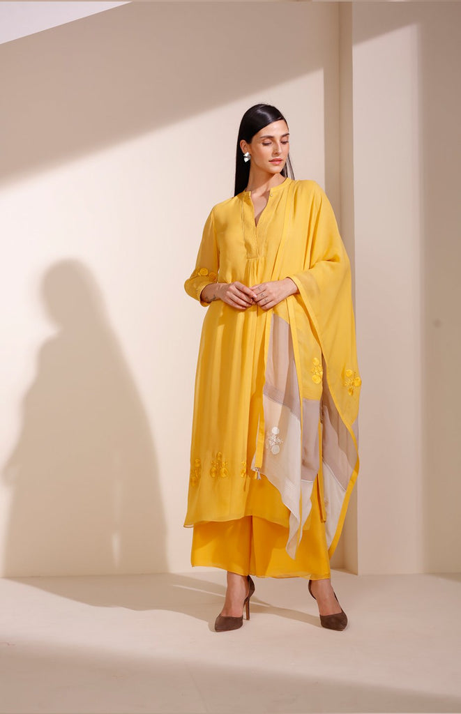 Mustard Suit In Georgette With Floral Embroidery