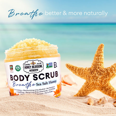 the Breathe, Body Scrub jar under the sea, with clear sand on it and a starfish to its right