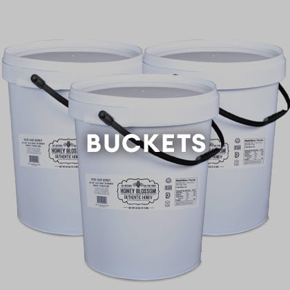 3 Honey Blossom's Honey Buckets, on a white background. And a title that says: Buckets
