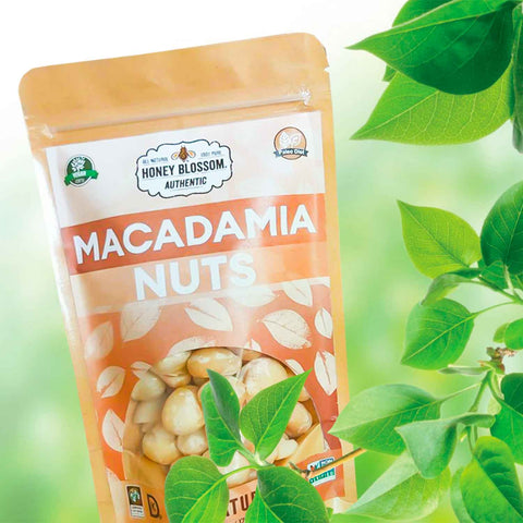 Image of the bag of macadamia nuts, in the middle of macadamia trees.