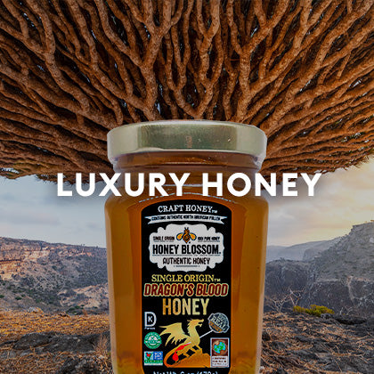 A dragon tree behind the dragon honey jar. And a title that says: Luxury Honey