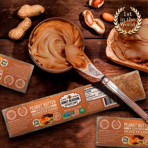 the Peanut Butter Chocolate Covered 100% RAW Honeycomb Snack Size, 5 Servings on a wooden table with a jar of peanut butter and chocolate bars next to it, a plate with toasted bread on top and cubes of honeycomb with peanut butter and chocolate