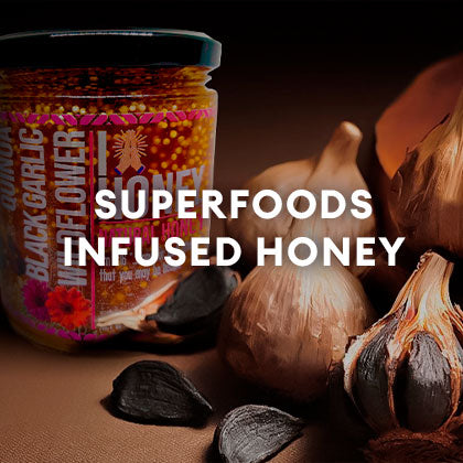 Honey Blossom's black garlic infused honey jar, with 5 black garlic on the right. And a caption that reads: Superfoods Infused Honey
